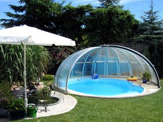 Schiebeüberdachung ORIENT schützt Ihren Pool vor Laube