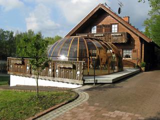 SPA GRAND SUNHOUSE® perfekt zum Holzhaus integriert