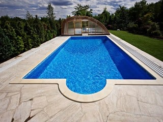 Front view on high pool enclosure Ravena with wood imitation finish