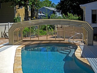 Fully retracted pool enclosure Oceanic high in beige color