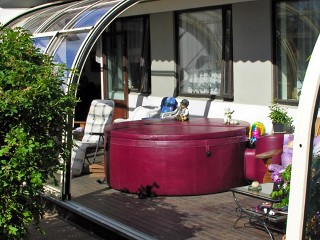Patio enclosure CORSO Entry can easily cover your hot tub