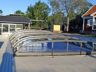 Low pool enclosure ELEGANT in a blooming garden
