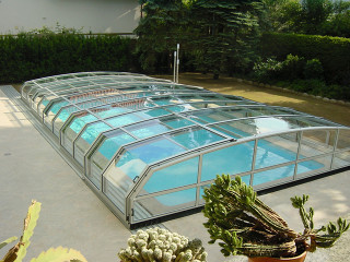 Retractable swimming pool enclosure OCEANIC on sea side