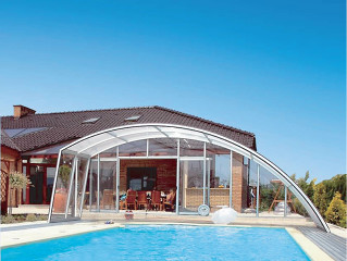 Pool enclosure RAVENA installed on a nearly wall