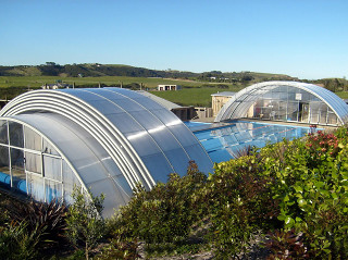Pool covered with enclosure UNIVERSE NEO can be used also in bad weather