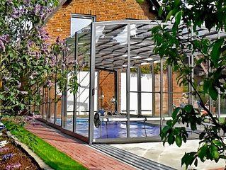 Abri de piscine ouvrable VISION par Alukov