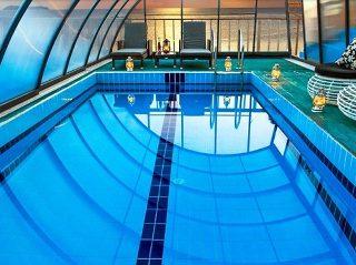 L'abri de piscine RAVENA