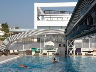 Retractable pool enclosure for public swimming pool 17