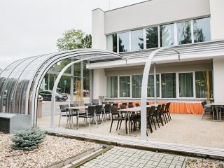 Fully retracted pool patio enclosure for Horeca
