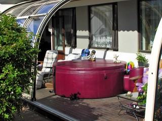 Look inside patio enclosure Corso ENTRY with hot tub