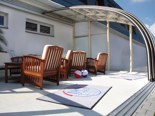 Innovative conservatory idea - retractable patio enclosure CORSO Entry