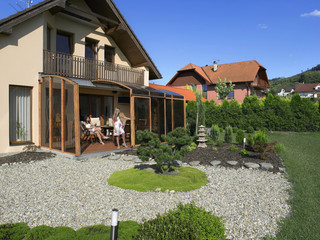 Patio enclosure CORSO fits great to your house - wood-like imitation on aluminum frames