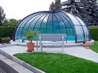 Pool enclosure ORIENT with dark polycarbonate panels and anthracite frames