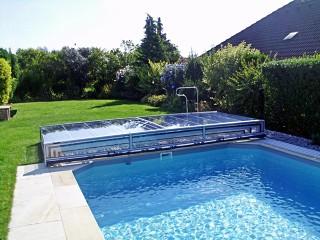 Retracted swimming pool enclosure Terra