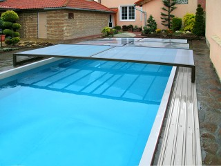 Semi opened pool enclosure Terra with auto retractable solar system