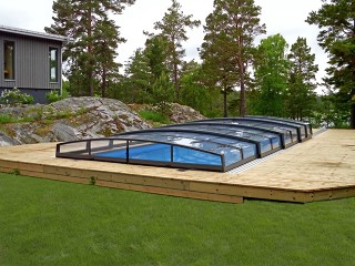 Swimming pool enclosure Corona fits perfectly into every garden