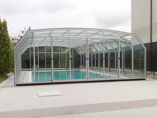Copertura telescopica per piscina con profili in alluminio e policarbonato modello Oceanic