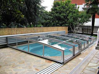 copertura per piscina trasparente in contato con la natura