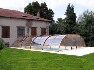 copertura telescopica per piscina con la paerete ribaltabile