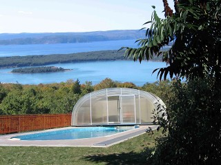Fully retracted pool enclosure Laguna with beautiful view in the background