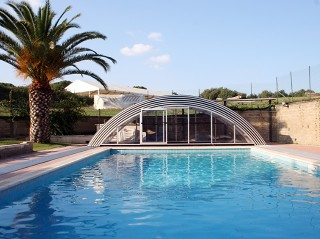 Fully retracted pool enclosure Universe with white finish