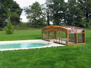 Fully retracted pool enclosure Vision with wood imitation finish