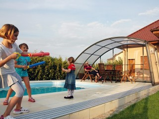 Playing kids near closed pool enclosure Ravena