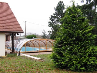 Pool enclosure UNIVERSE fits great over your pool - halfopened