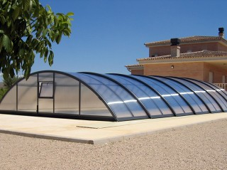 Retractable swimming pool enclosure Universe with anthracite finish