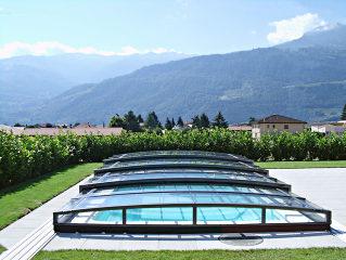 Zwembadoverkapping CORONA behoud uw zicht naar de tuin