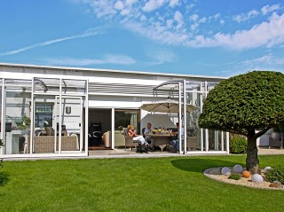 Enjoying of summer days under patio enclosure CORSO Solid with white finish