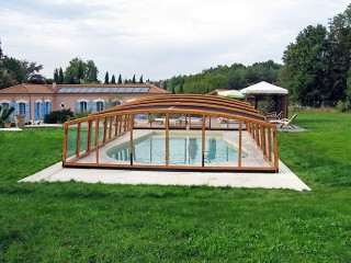 Front look on pool enclosure Venezia with wood imitaion finish