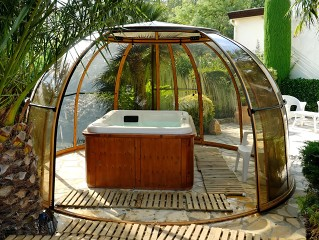 Look into hot tub enclosure Spa dome Orlando with wood imitation finish