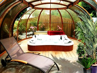 Look into spacious hot tub enclosure Spa Sunhouse