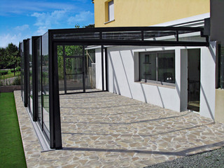 Patio enclosure CORSO Glass is mounted in nearby wall and can be easily moved in both directions