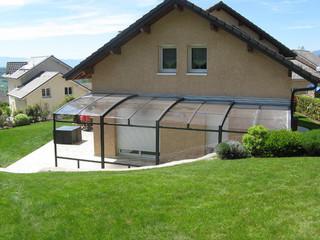 Innovative conservatory - retractable patio enclosure CORSO Premium