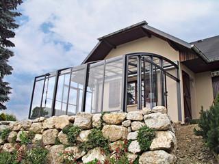 Retractable patio cover CORSO Solid - on a rocky foundation