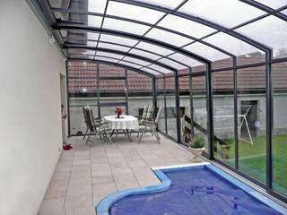 Retractable patio enclosure CORSO Solid as a 2in1 patio and pool enclosure