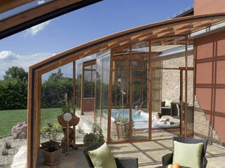 Patio enclosure CORSO Solid can also cover your inground spa pool