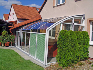 Patio enclosure CORSO in white with shading systen on front segment