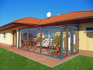 Telescopic veranda enclosure CORSO on brick wall