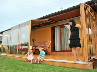 Long and spacious patio enclosure CORSO in popular wood-like finish