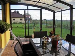 Telescopic patio enclosure CORSO can also cover pool - look from inside