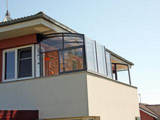Retractable patio enclosure CORSO Solid used as a balcony enclosure