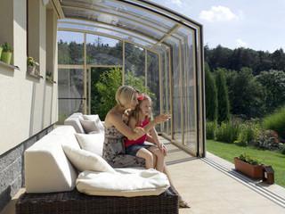 Fully opened retractable patio enclosure CORSO Solid