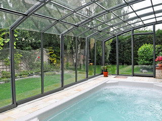 Retractable patio cover CORSO Solid can also cover your spa pool