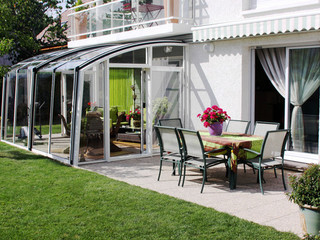 Fully opened patio enclosure CORSO Solid in modern white color