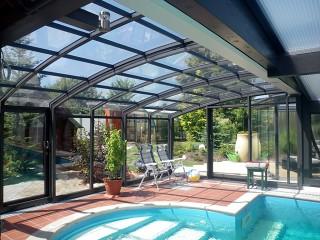 Patio enclosure CORSO Solid used as a pool enclosure