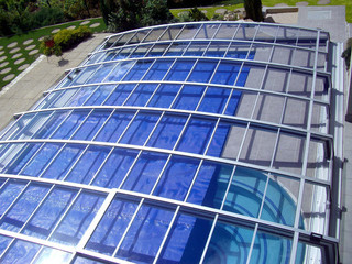 Swimming pool enclosure CORONA keeps your pool clean from leaves and debris