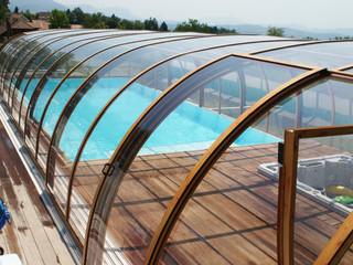 Wood like finish on aluminium frames used on swimming pool enclosure LAGUNA